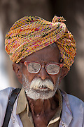 Indian man, the local barber, in typical Rajasthani village of Nimaj, Rajasthan, Northern India