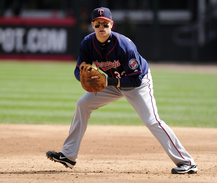 CHICAGO - APRIL 20:  Justin Morneau #33 of the MInnesota Twins fields against the Chicago White Sox on April 20, 2013 at U.S. Cellular Field in Chicago, Illinois.  The Twins defeated the White Sox 2-1 .  (Photo by Ron Vesely)   Subject:  Justin Morneau