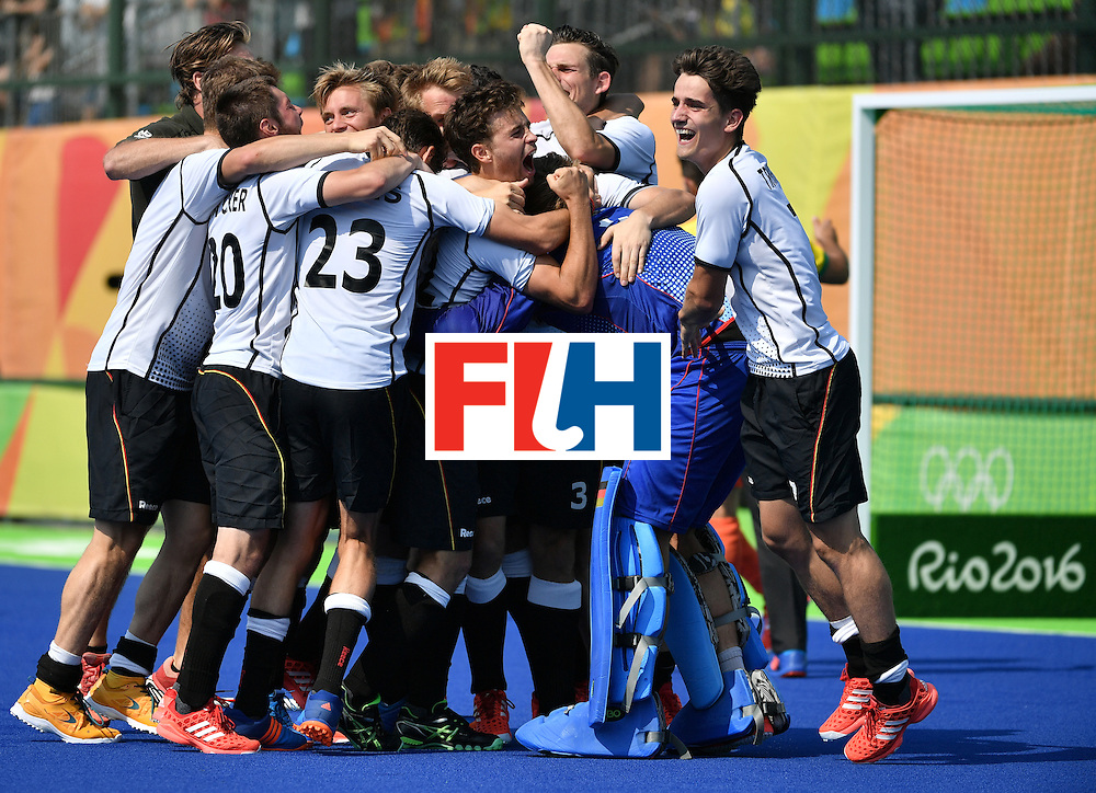 Germany's players celebrate after winning the men's Bronze medal field hockey Netherlands vs Germany match of the Rio 2016 Olympics Games at the Olympic Hockey Centre in Rio de Janeiro on August 18, 2016. / AFP / Pascal GUYOT        (Photo credit should read PASCAL GUYOT/AFP/Getty Images)