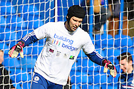 Petr Cech of Chelsea wearing a ' Building Bridges ' campaign t-shirt as he warms up before the Barclays Premier League match at Stamford Bridge, London<br /> Picture by David Horn/Focus Images Ltd +44 7545 970036<br /> 22/02/2014