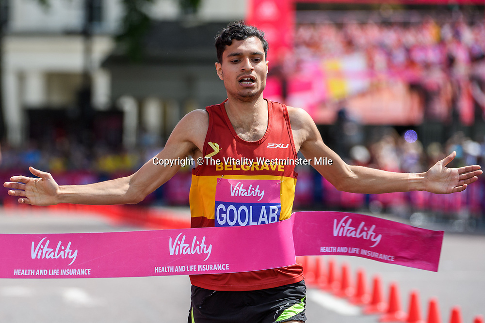 Nick Goolab crosses the line to win the Senior Men's British One Mile Road Race at The Vitality Westminster Mile, Sunday 28th May 2017.<br /> <br /> Photo: Thomas Lovelock<br /> <br /> For further information: media@londonmarathonevents.co.uk
