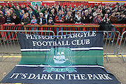 Plymouth fans cheer their team on to the pitch before the start of the Sky Bet League 2 match between Exeter City and Plymouth Argyle at St James' Park, Exeter, England on 2 April 2016. Photo by Graham Hunt.