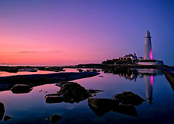 © Licensed to London News Pictures. 30/08/2018. Whitley Bay, UK. Sunset at St Marys Lighthouse, Whitley Bay on the North Eat coast, on August 29th, 2018 as the UK approaches he beginning of meteorological autumn. Photo credit: Colin Scarr/LNP