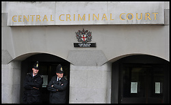 police Officers stand outside The Central Criminal Court  (The Old Bailey) during the preliminary hearing as Eight are charged over alleged News of the World phone hacking, London, Wednesday September 26, 2012 Photo Andrew Parsons / i-Images..