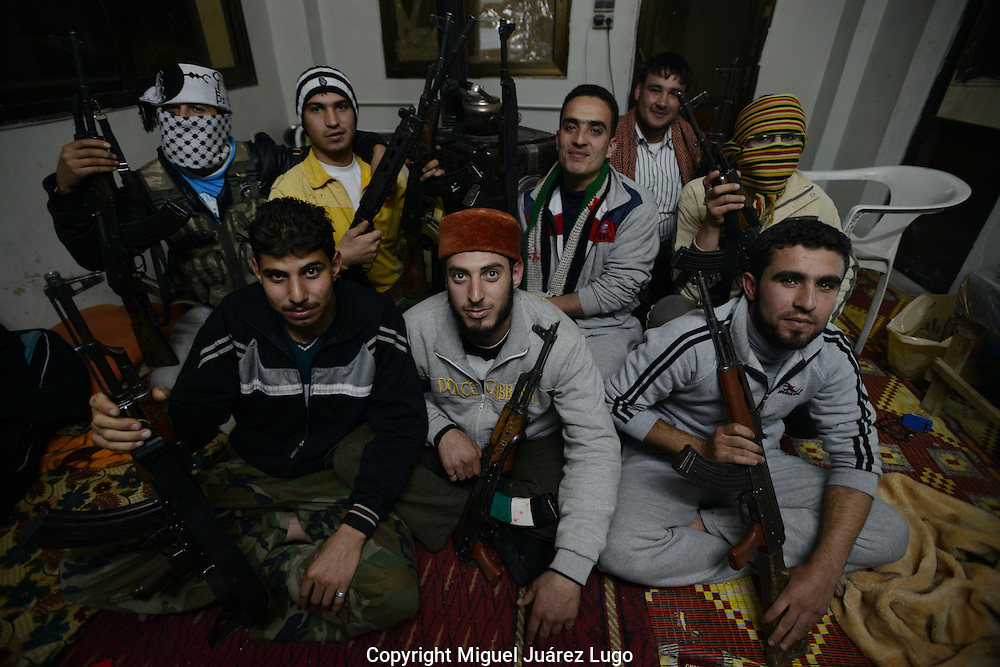 Aleppo, Syria, January, 2013.-  Syrian Army defector soldiers, now members of the FSA, gather in an clandestine house, planning  an operation to attack a post of the Syrian Army in the area near the airport known as Jobrile. (Photo by Miguel Juárez Lugo)