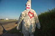 Pupazzi  in memoria di incidente mortale, via Laurentina - puppets along the street in memory of a fatal car accident.