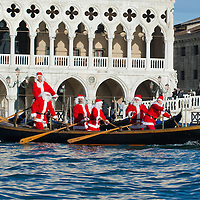 VENICE, ITALY - DECEMBER 26: Rowers dressed as Father Christmas escort a gondola a live nativity scene from St Mark's to the Island of S Giorgio on December 26, 2011 in Venice, Italy.  The event is in its first year wants and to replicate an ancient tradition when the Doge of Venice used to go to the Island of S Giorgio to celebrate the relics of Santo Stefano on Boxing Day. HOW TO LICENCE THIS PICTURE: please contact us via e-mail at sales@xianpix.com or call our office London   +44 (0)207 1939846 for prices and terms of copyright. First Use Only ,Editorial Use Only, All repros payable, No Archiving.© MARCO SECCHI