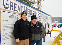 "Kevin Kelly and Jim McFarlin working the ""wall"" during the Great Meredith Rotary Ice Fishing Derby on Saturday afternoon.  (Karen Bobotas/for the Laconia Daily Sun)"