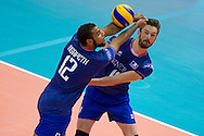 (L) Earvin Ngapeth from France receives the ball during the 2013 CEV VELUX Volleyball European Championship match between France and Turkey at Ergo Arena in Gdansk on September 22, 2013.<br /> <br /> Poland, Gdansk, September 22, 2013<br /> <br /> Picture also available in RAW (NEF) or TIFF format on special request.<br /> <br /> For editorial use only. Any commercial or promotional use requires permission.<br /> <br /> Mandatory credit:<br /> Photo by © Adam Nurkiewicz / Mediasport