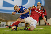 Curtis Main (on loan from Doncaster Rovers) (Oldham Atheltic) is tackled by Marc Roberts (Barnsley) before he can cross the ball during the Sky Bet League 1 match between Barnsley and Oldham Athletic at Oakwell, Barnsley, England on 12 April 2016. Photo by Mark P Doherty.