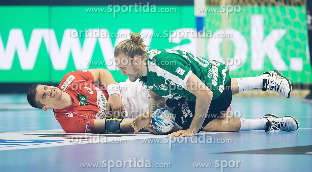 Berlin, Deutschland, 16.05.2015:<br /> Handball EHF Pokal Halbfinale Spiel 1 2014 / 2015 - Skjern Handbold - HSV Hamburg - EHF CUP Finals 2014/15.<br /> <br /> Alexandru Viorel Simicu (HSV #4) - Henrik Moellgaard Jensen (Skjern Handbold #6) *** Local Caption *** &copy; pixathlon