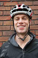 Portrait of happy biker wearing crash helmet