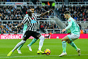 Mohamed Diame (#10) of Newcastle United looks to take on Lewis Cook (#16) of Bournemouth during the Premier League match between Newcastle United and Bournemouth at St. James's Park, Newcastle, England on 10 November 2018.
