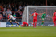 Christopher Routis scores Bradford's first goal during the Capital One Cup match between York City and Bradford City at Bootham Crescent, York, England on 11 August 2015. Photo by Simon Davies.