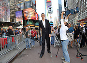 Monday, September 21, 2009, New York, New York, USA - Towering at 8 foot 1-inch, Sultan Kosen is unveiled as the world's tallest man by Guinness World Record in Times Square.  A triple record-holder, Sultan has the largest hands and largest feet, he is also the first man over 8 feet to be measured by Guinness in over 20 years and will be featured in the Guinness World Record 2010 edition.