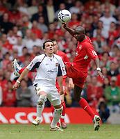 Photo: Daniel Hambury.<br />Liverpool v West Ham United. The FA Cup Final. 13/05/2006.<br />West Ham's Matthew Etherington and Liverpool's Mohamed Sissoko battle.