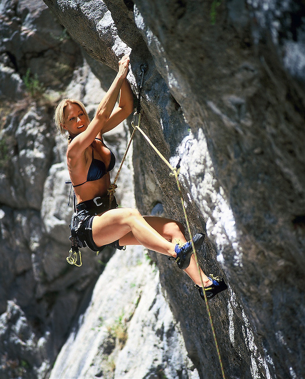 San Diego Fitness Photographer: Young woman rock climbing at Big Bear, California, USA, North America.  Robert Randall Productions Fitness Photographer