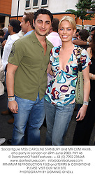 Social figure MISS CAROLINE STANBURY and MR CEM HABIB, at a party in London on 29th June 2003.PKY 46