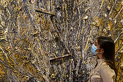 "© Licensed to London News Pictures. 16/06/2020. LONDON, UK. A staff member wearing a facemask views ""Memento Mori"", 2020, by Anselm Kiefer on the opening day of a new exhibition ""Art Basel at Ely House"" taking place at Galerie Thaddaeus Ropac in Mayfair.  The commercial gallery has implemented social distancing guidelines for visitors for its reopening after coronavirus pandemic lockdown restrictions were relaxed by the UK government.  The exhibition runs 16 June to 31 July 2020.  Photo credit: Stephen Chung/LNP"