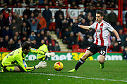 Rotherham United goalkeeper Lewis Price (12) saves a shot from Brentford Sergi Canos (47) during the EFL Sky Bet Championship match between Brentford and Rotherham United at Griffin Park, London, England on 25 February 2017. Photo by Andy Walter.