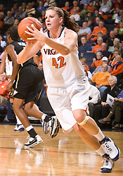 Virginia forward Kelly Hartig (42) grabs a rebound in action against Colorado.  The #16 ranked Virginia Cavaliers women's basketball team defeated the Colorado Buffaloes 77-43 at the John Paul Jones Arena on the Grounds of the University of Virginia in Charlottesville, VA on November 24, 2008.