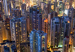 Night view of dense high rise apartment buildings on Hong Kong Island