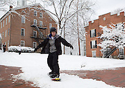 Ohio University sophomore Spencer Wien snowboards near Alden Library on Feb. 3, 2014, when classes were canceled due to inclement weather. Photo by Lauren Pond
