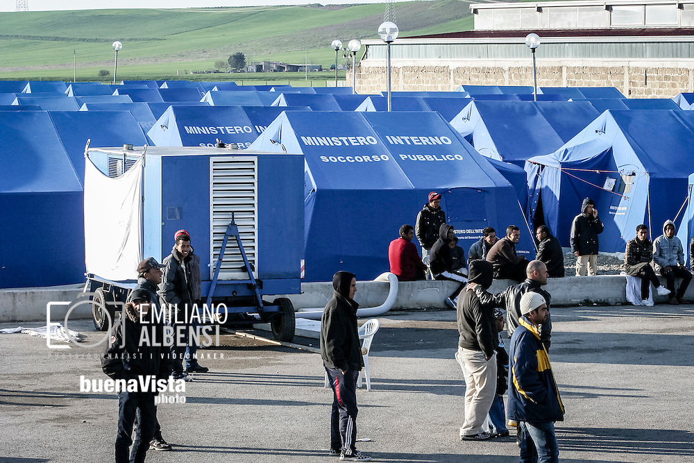 Emiliano Albensi<br /> 13/04/2011 Palazzo San Gervasio (Potenza)<br /> Migranti, CIE Palazzo S.Gervasio<br /> Nella foto: migranti nella tendopoli del Centro Identificazione ed Espulsione di Palazzo San Gervasio, in Basilicata. Il centro &egrave; stato chiuso nell'estate del 2011.<br /> <br /> Emiliano Albensi<br /> 13/04/2011 Palazzo San Gervasio (Potenza)<br /> Migrants, Identification and Expulsion Centre in Palazzo S.Gervasio<br /> In the picture: migrants in the tent city of the  Identification and Expulsion Centre in Palazzo San Gervasio, in Basilicata region in southern Italy. The centre was closed in the summer of 2011.