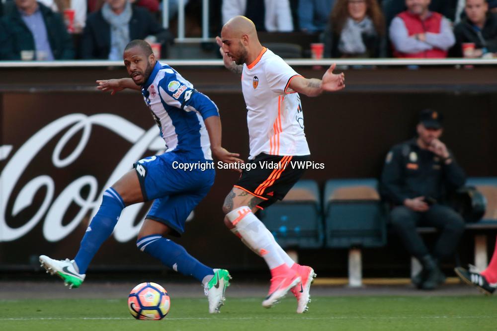 Valencia CF vs Deportivo La Coruña - La Liga MAtchday 29 - Estadio Mestalla, in action during g the game -- Simone Zaza for VAlencia CF (right) presses Sidnei, central defender of Deportivo La Coruña (left) fighting for the ball
