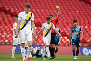 Oxford United midfielder Alejandro Rodriguez Gorrin (6) receives a yellow card during the EFL Sky Bet League 1 Play Off Final match between Oxford United and Wycombe Wanderers at Wembley Stadium, London, England on 13 July 2020.
