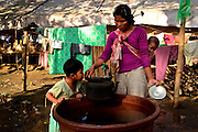 Kachin refugee housewives ai Je Yang Hka near China Myanmar boarder Lai Za. A refugee housewife with her two daughters taking water for cooking.