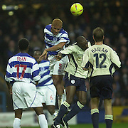 29/11/2003 - Photo  Peter Spurrier.2003/04 Nationwide Football Div 2 QPR V Sheffield Wed.Clarke Carlisle out jumps to clear the ball.