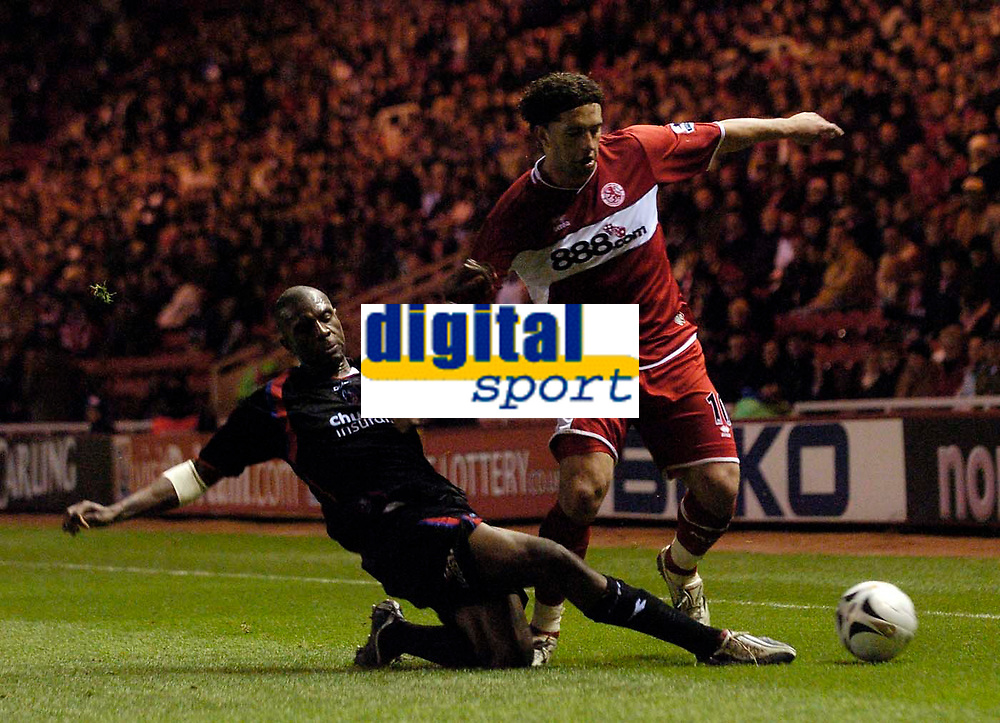 Photo: Jed Wee.<br /> Middlesbrough v Crystal Palace. Carling Cup. 30/11/2005.<br /> <br /> Middlesbrough's Fabio Rochemback (R) is tackled by Crystal Palace's Emmerson Boyce.