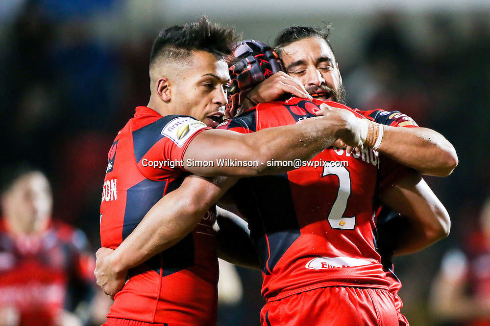 Picture by Alex Whitehead/SWpix.com - 12/02/2015 - Rugby League - First Utility Super League - Salford Red Devils v St Helens - AJ Bell Stadium, Salford, England - Salford's Ben Jones-Bishop (centre) is congratulated on his try by Greg Johnson (L) and Rangi Chase (R).