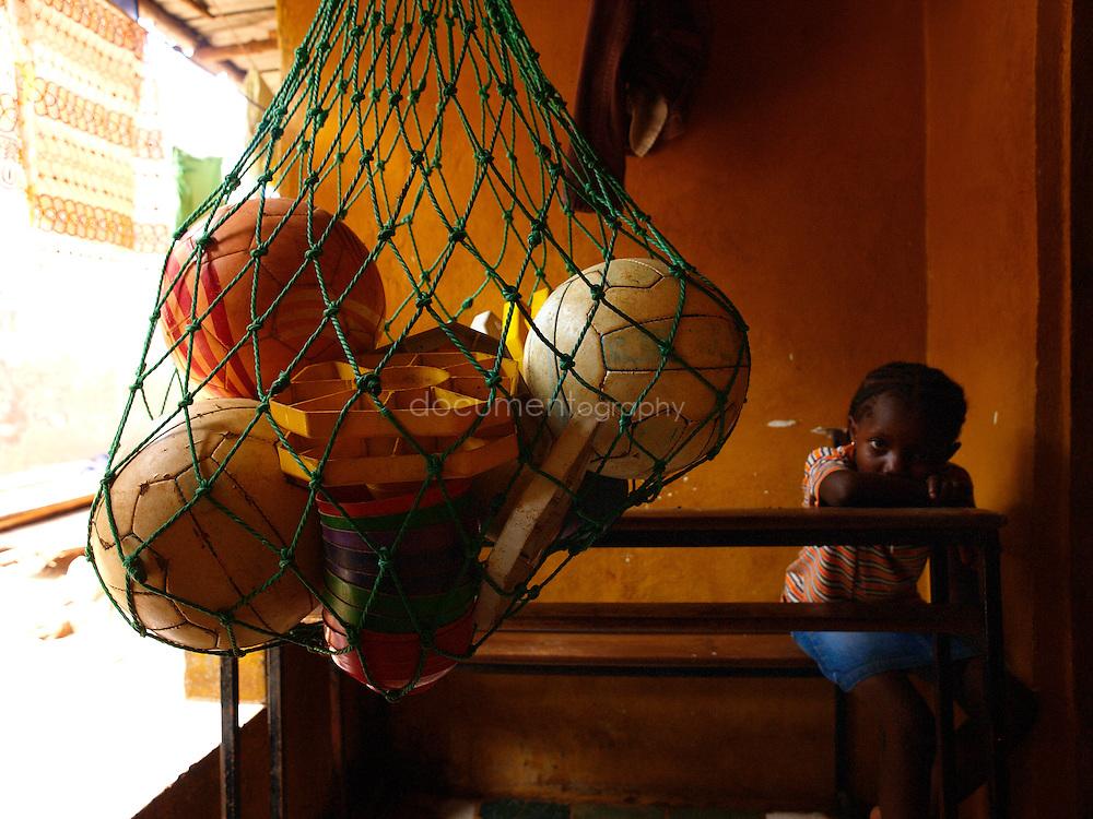 Footballs in a net, Kroobay, Freetown, Sierra Leone
