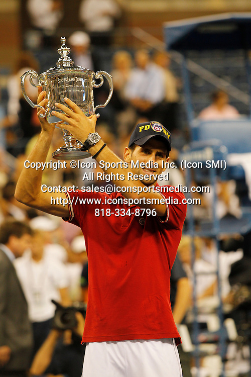 September 12, 2011:  Novak Djokovic (SRB)[1] holds up the 2011 US Open Championship Trophy after his match against Rafael Nadal (ESP)[2] at the US Open in Arthur Ashe Stadium at the Billie Jean King Tennis Center in Flushing, New York.  Novak Djokovic (SRB)[1] defeats Rafael Nadal (ESP)[2] in four sets by the score of 6-2 6-4 6-7 (3) 6-1. Novak Djokovic is the 2011 US Open Mens Champion.
