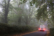 A vehicle brakes to corner a tight bend on a rural Northumbrian road, early on an autumnal morning, on 26th September 2017, in Eshott, Northumberland, England.