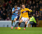 3rd November 2018, Fir Park, Motherwell, Scotland; Ladbrokes Premiership football, Motherwell versus Dundee; Tom Aldred of Motherwell and Sofien Moussa of Dundee