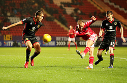 Charlton Athletics Ben Reeves beats Milton Keynes Dons Ed Upson during the Sky Bet League One match at The Valley, Charlton.