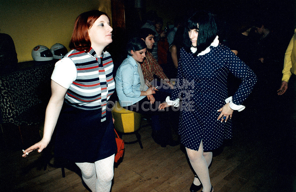 Two women dancing at a party.
