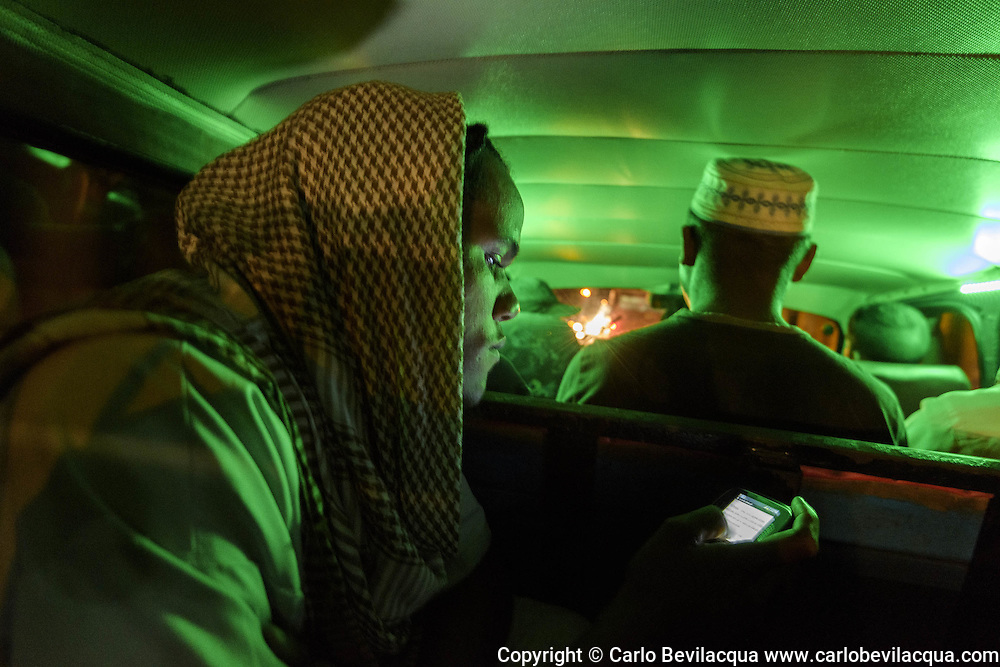 Abdullah reading an Islamic book in a collective taxi in Havana.