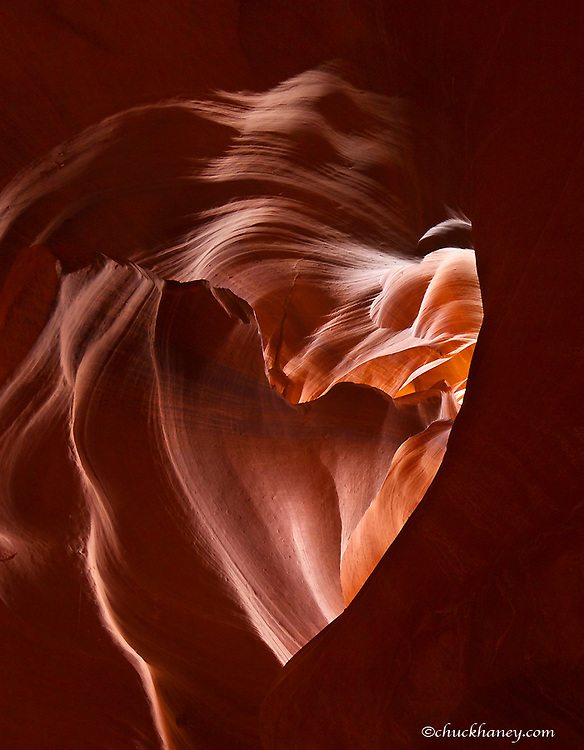 Light beams down into Upper Antelope Canyon forming a heart shape on the Navajo Reservation near Page, Arizona, USA