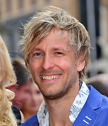 Bula Quo UK film premiere.  <br /> Rick Parfitt Jnr attends premiere of Status Quo action film featuring 12 of the rock band's classic tracks. Directed by former stunt co-ordinator Stuart St Paul, starring Jon Lovitz, Craig Fairbrass, Laura Aikman and the band members themselves. Released July 5. Odeon West End, London, United Kingdom.<br /> Monday, 1st July 2013<br /> Picture by Nils Jorgensen / i-Images