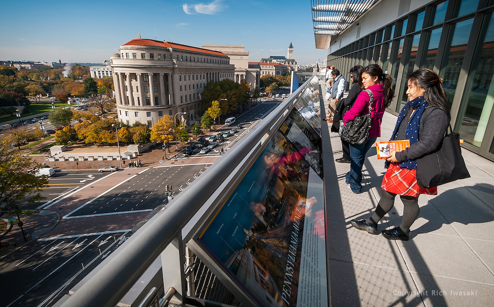 Visitors view exhibit rail on the Hank Greenspun Terrace at the Newseum, Washington, DC. The terrace overlooks Pennsylvania Avenue and other city landmarks.