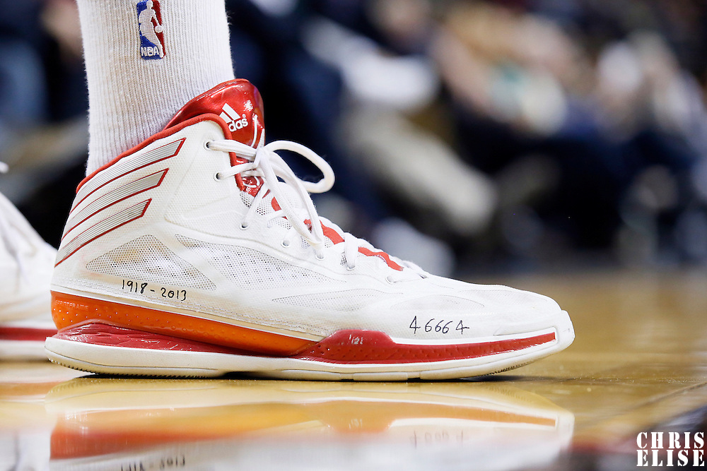 06 December 2013: Portland Trail Blazers small forward Nicolas Batum (88) pays homage to deceased former South Africa President Nelson Mandela by having dates of Birth/Death and '46664' (meaning prisoner number 46, june 1964) scribbled on his game shoes during the Portland Trail Blazers 130-98 victory over the Utah Jazz at the Moda Center, Portland, Oregon, USA.
