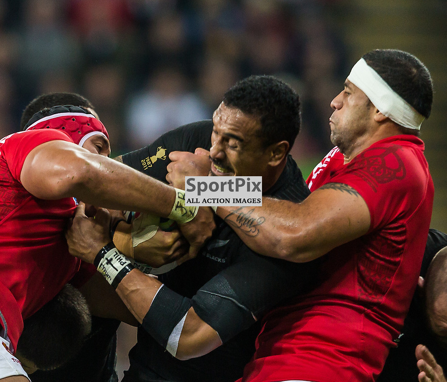 Lua Lokotui tackles Jerome Kaion round the neck during the Rugby World Cup match between New Zealand and Tonga (c) ROSS EAGLESHAM | Sportpix.co.uk