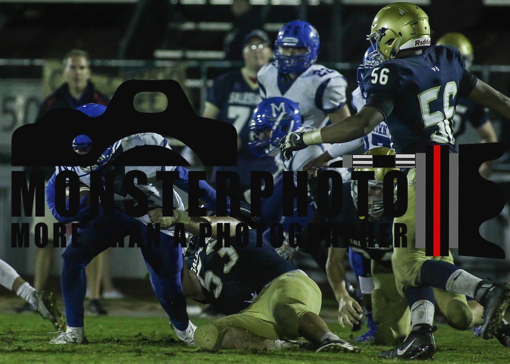Middletown defensive back Ernest Washington (5) attempts to escape from Salesianum defensive linemen Devin Schofield (53) in the third quarter Friday, Oct. 09, 2015 at Bernard Stadium in Wilmington, DE.
