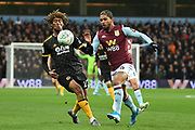Aston Villa midfielder Douglas Luiz (6) battles for possession  with Wolverhampton Wanderers defender Dion Sanderson (23) during the EFL Cup match between Aston Villa and Wolverhampton Wanderers at Villa Park, Birmingham, England on 30 October 2019.