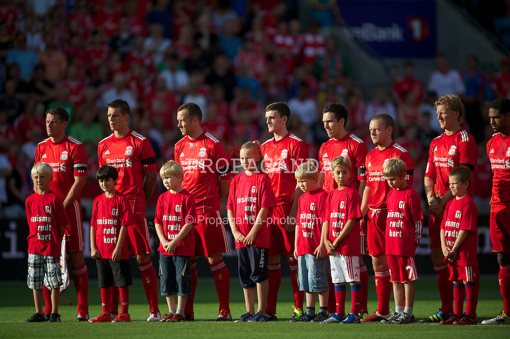 OSLO, NORWAY - Monday, August 1, 2011: Liverpool's players stand for a minute's silence in memory of the vicitms of the Oslo bomb and Utoya shooting massacre during a preseason friendly match against Valerenga at the Ulleval Stadion. (Photo by David Rawcliffe/Propaganda)