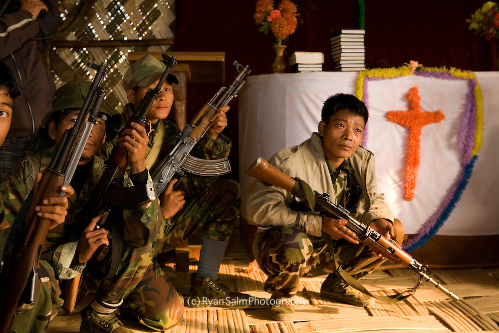 A small group of Naga rebels rest in a makeshift bamboo church which stands on their camp in Mon.